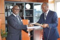 Afreximbank president Jean-Louis Ekra (left) signs MOU with ICCO executive director Jean-Marc Anga